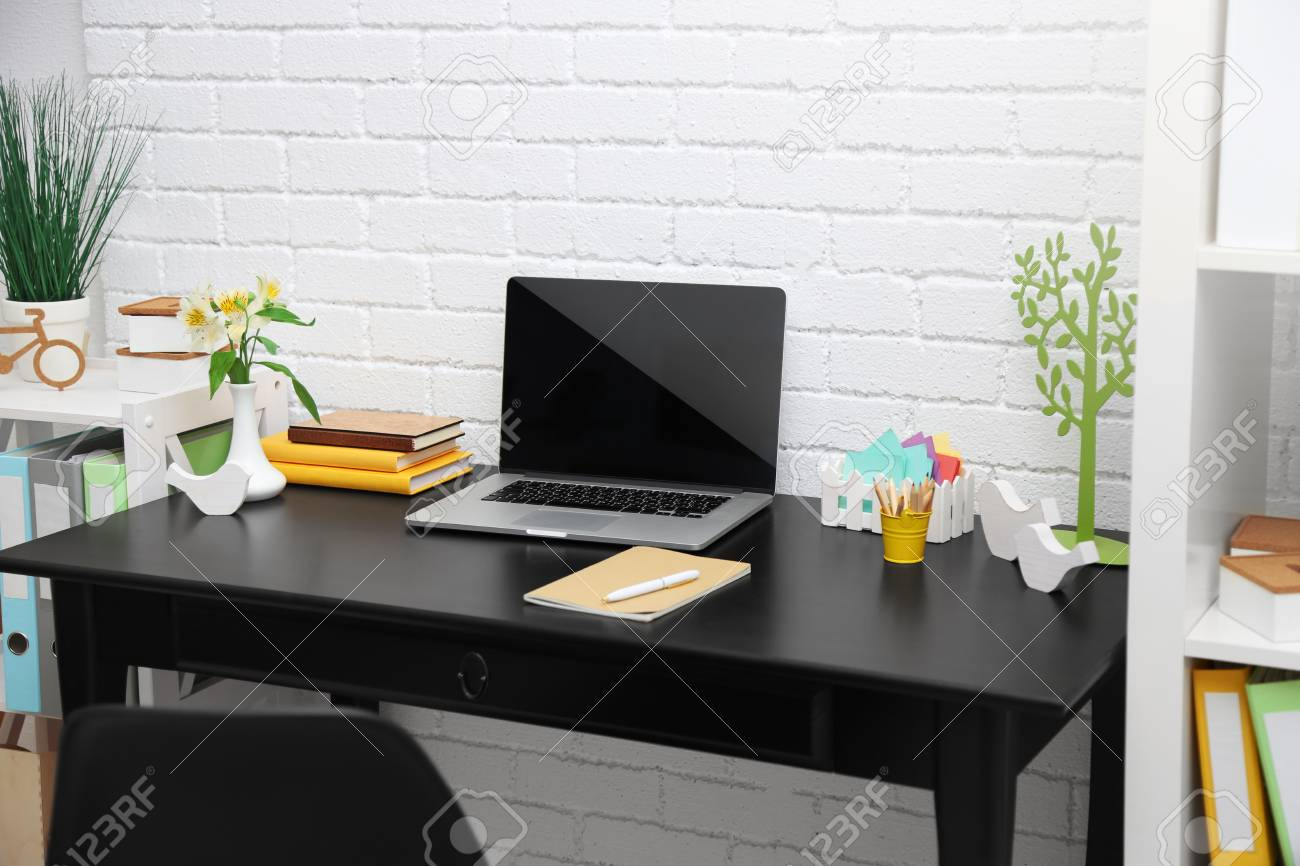 Stylish workplace with laptop at home - 104301954