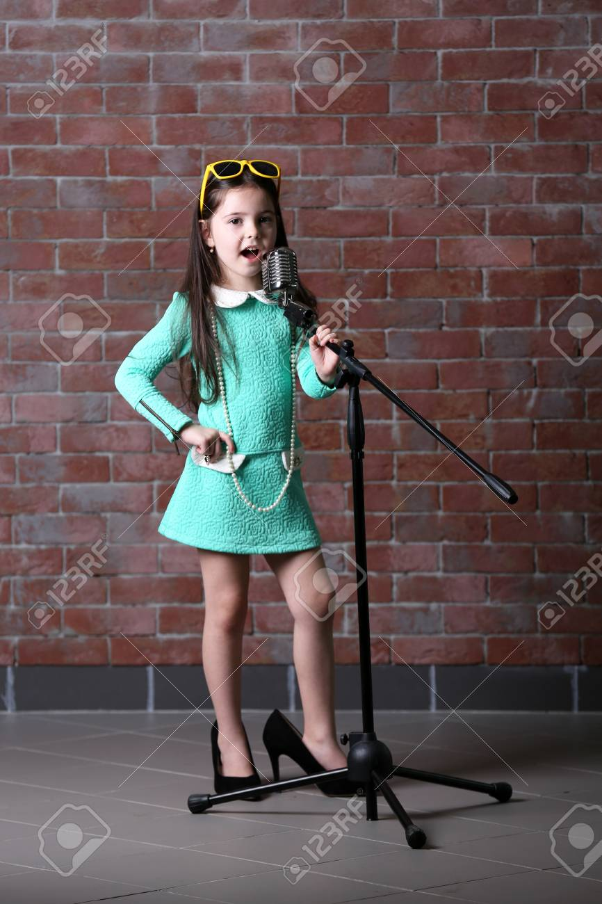790e483bb89d Stock Photo - Beautiful little girl in dress and
