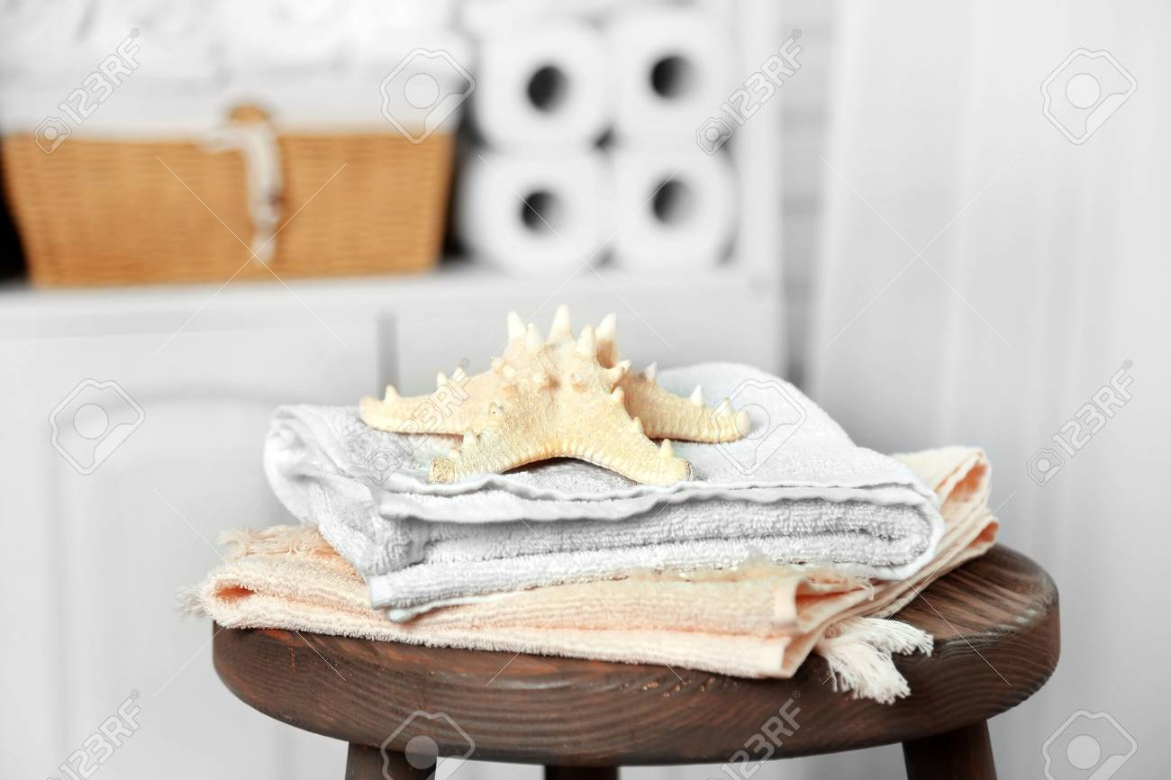 Bathroom Set With Towels And Starfish On Stool In Light Interior ...