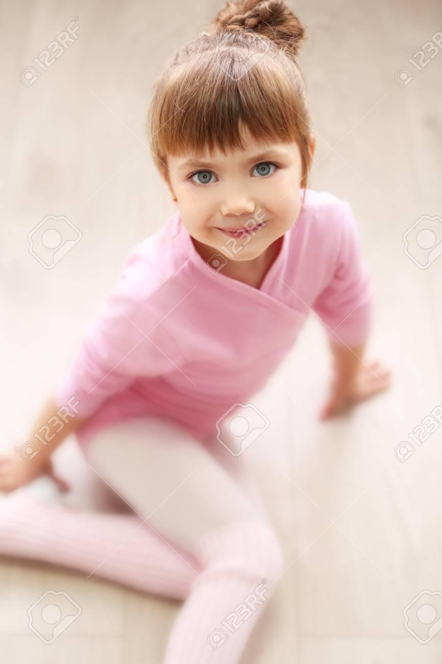eedc33e3a98d Little Cute Girl In Pink Leotard Sitting On Floor At Dance Studio ...