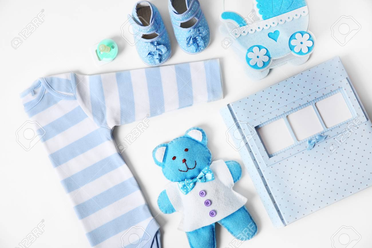 5579c001d90e Baby Clothes With Toys And Photo Album On White Background Stock ...
