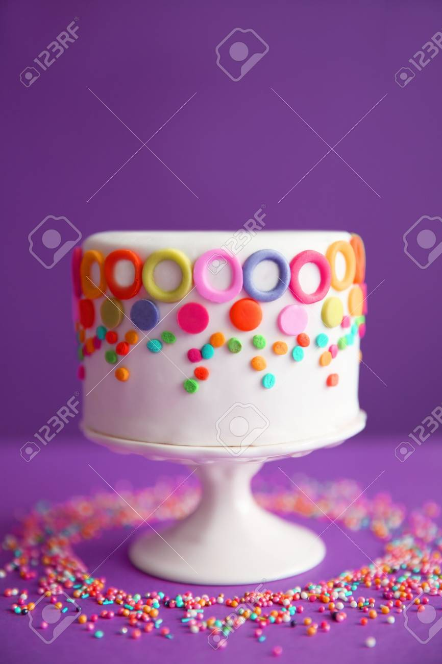 Birthday Cake With Colorful Decorations On Purple Background Standard Bild