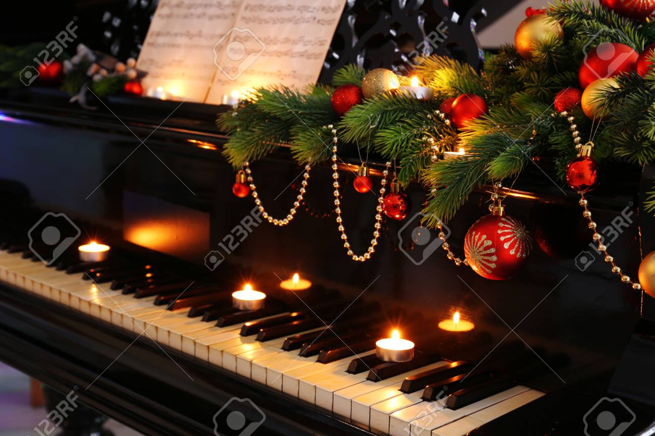 Christmas Piano.Piano Keys With Christmas Decorations Closeup
