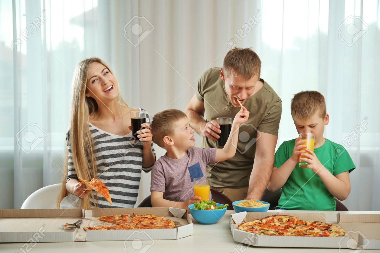 Happy lovely family eating pizza - 108839008