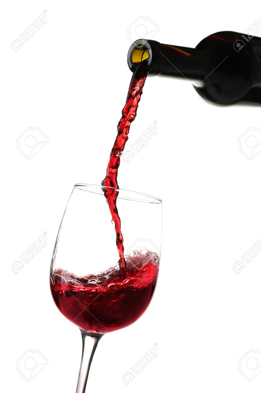 red wine pouring into glass on white background stock photo picture