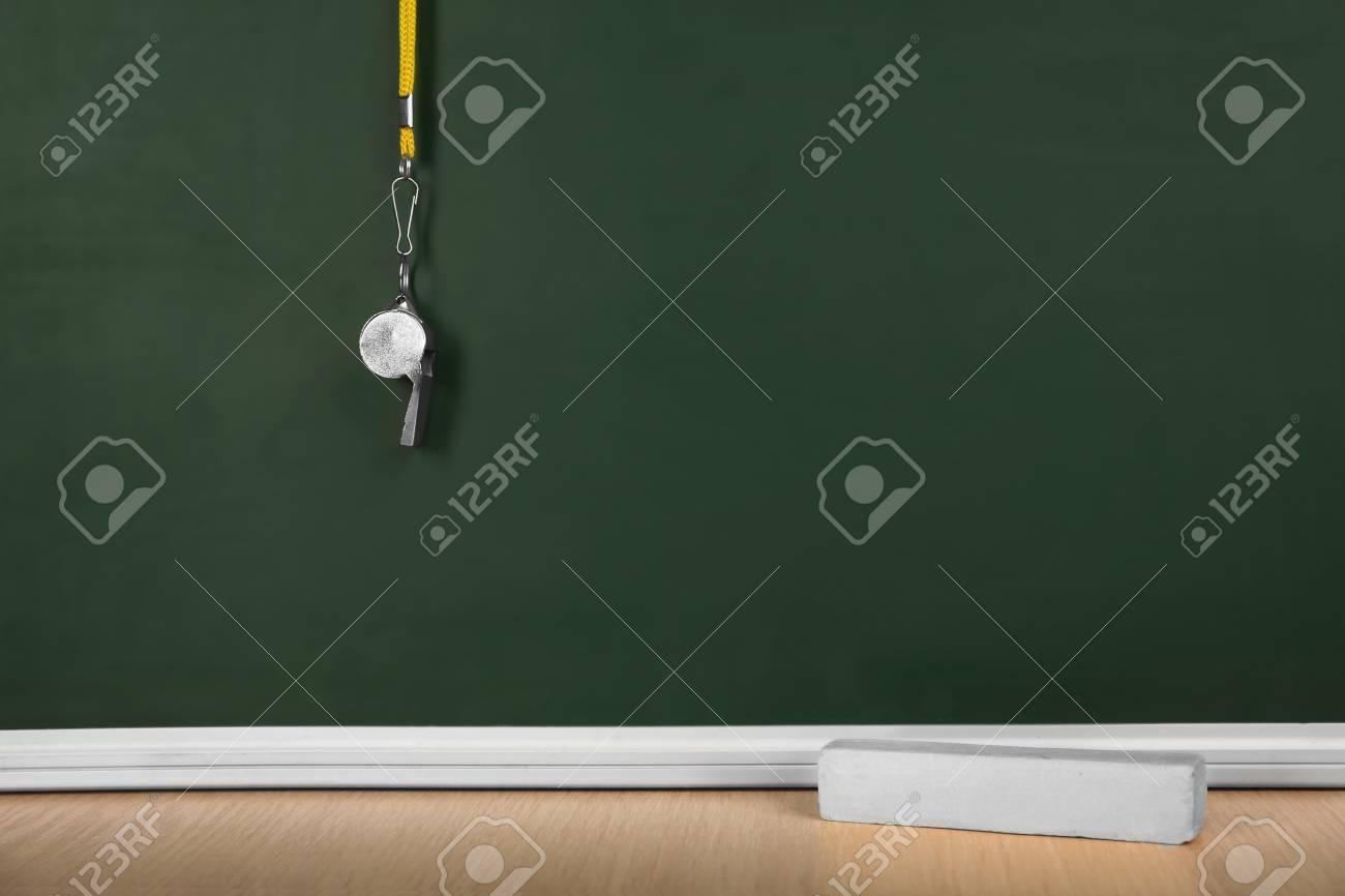 Whistle on blackboard background - 106995312