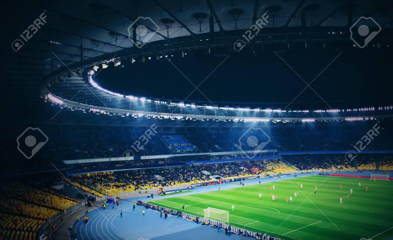 Panoramic view of modern stadium during football match - 132069111
