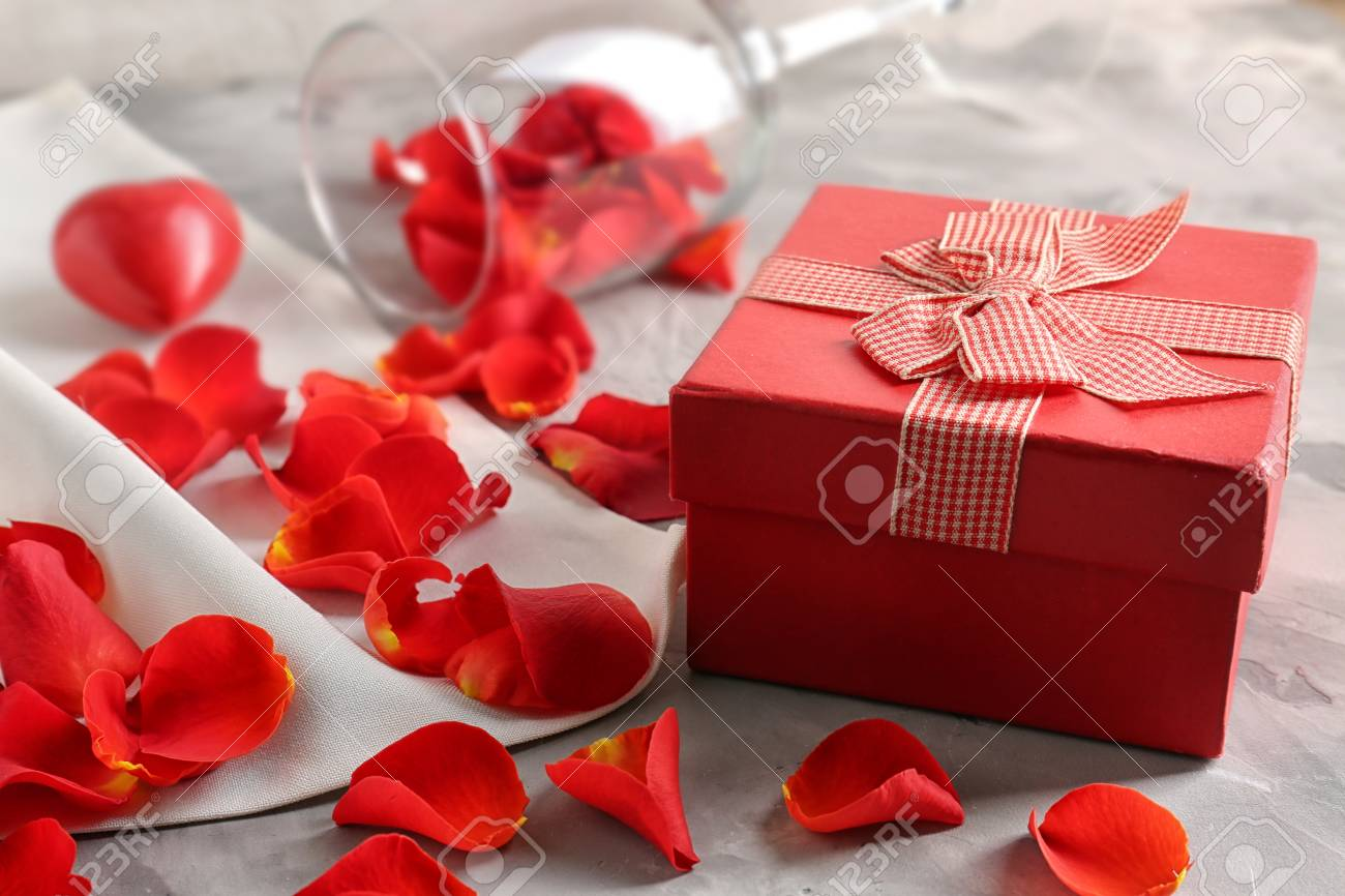 St Valentines Day Concept Gift Box Petals And Empty Wine Glass On