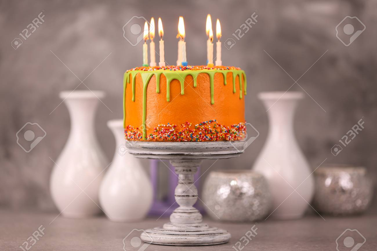 Delicious Cake With Happy Birthday Candles On Light Background Stock Photo
