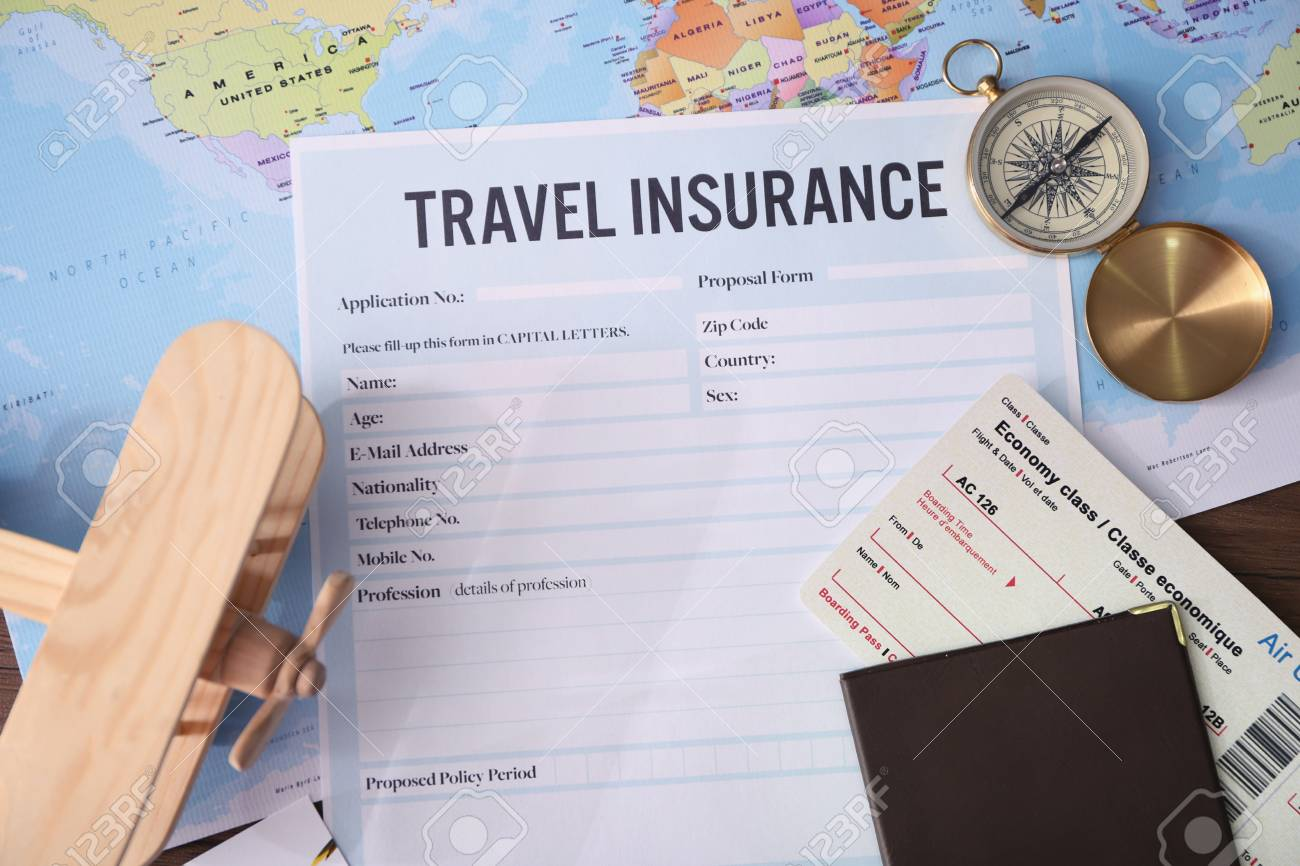Blank travel insurance form and map on background - 109348261