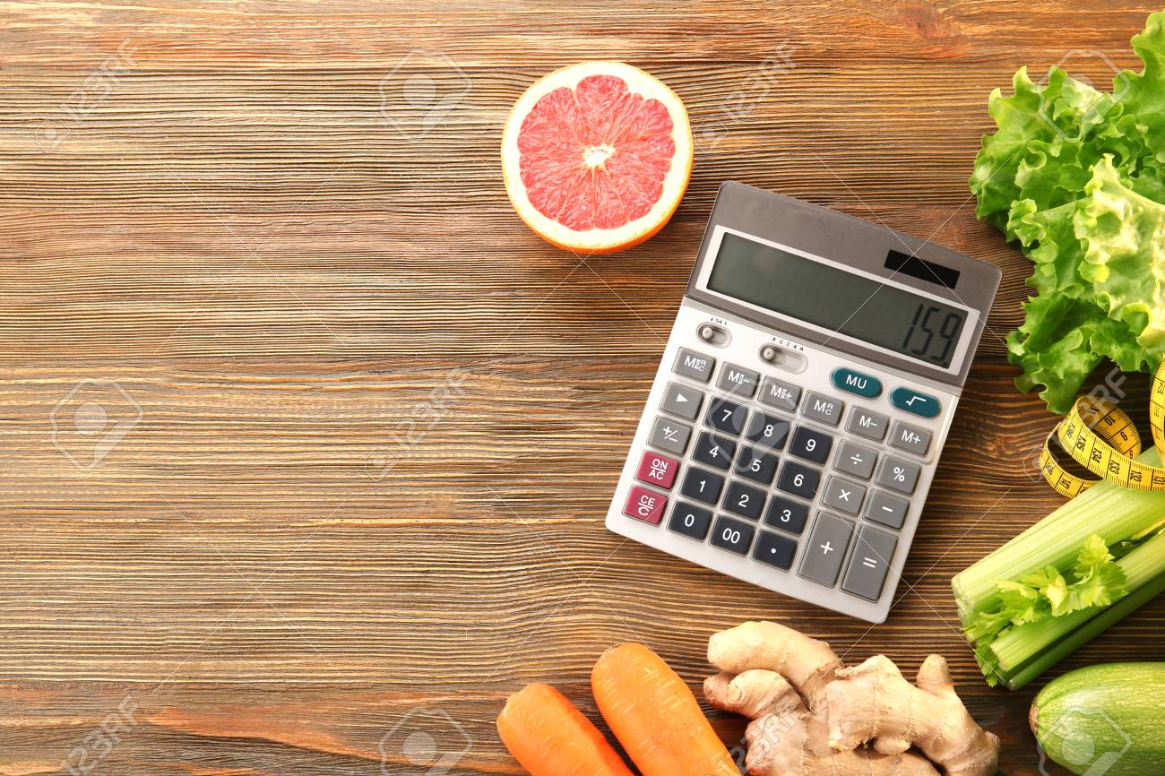 diet concept calculator measuring tape and different groceries
