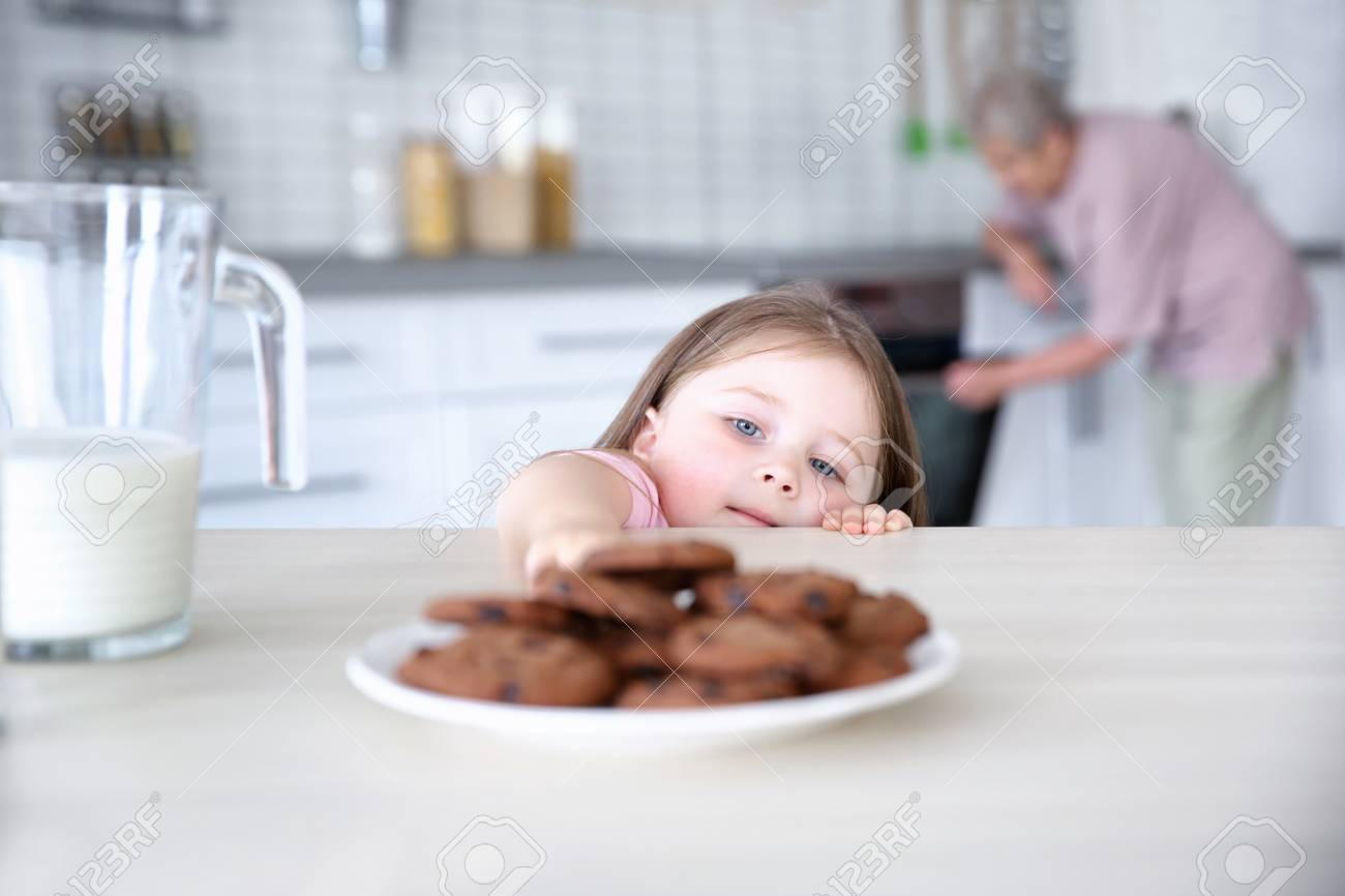 Image result for little girl with cookies on a plate