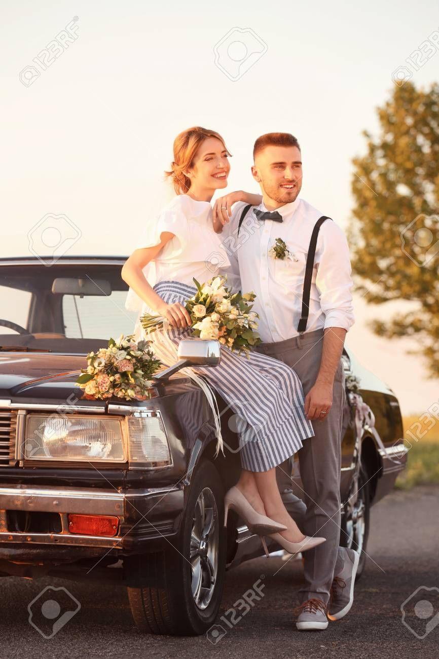 Happy Wedding Couple And Decorated Car Outdoors Stock Photo Picture And Royalty Free Image Image 111239215