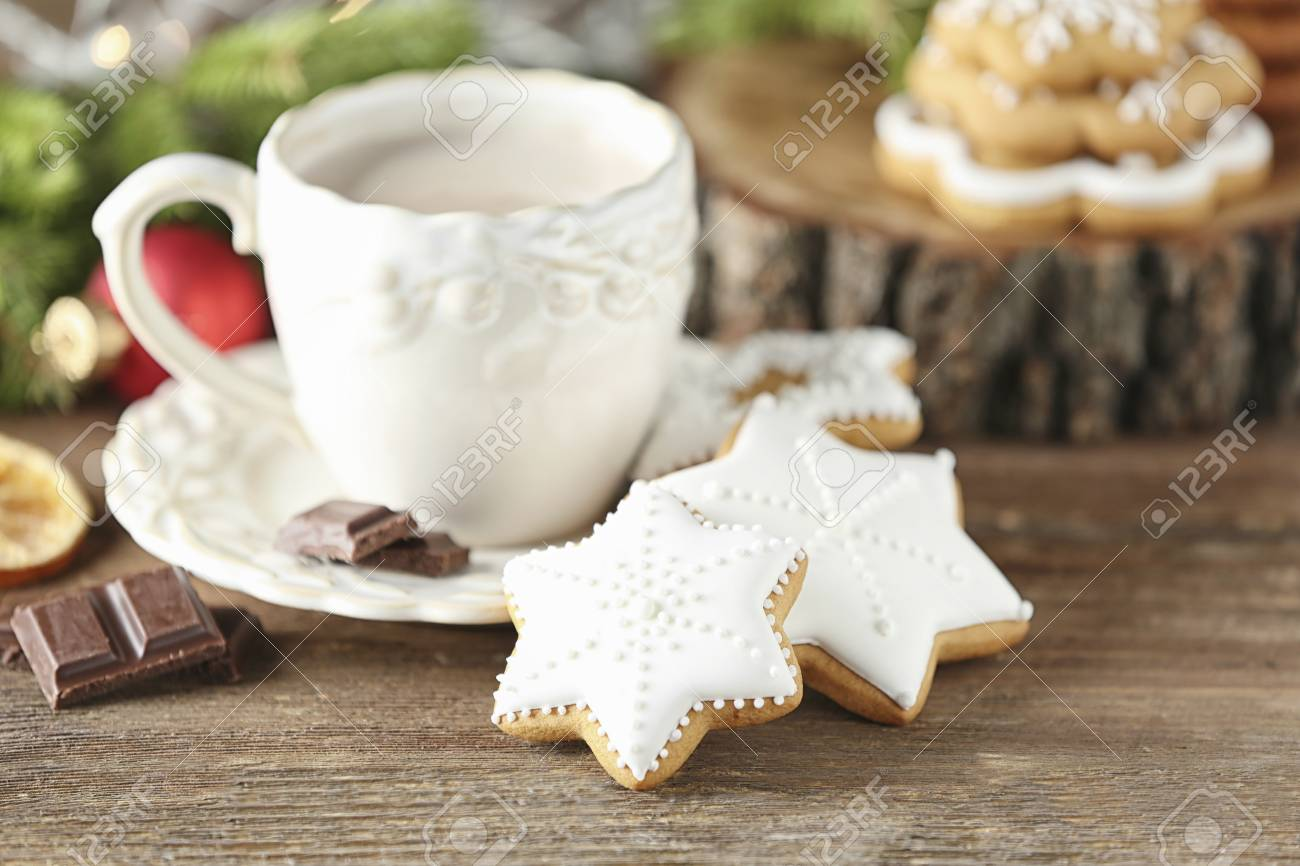 Creative Christmas Cookies And Cup Of Hot Drink On Table Stock