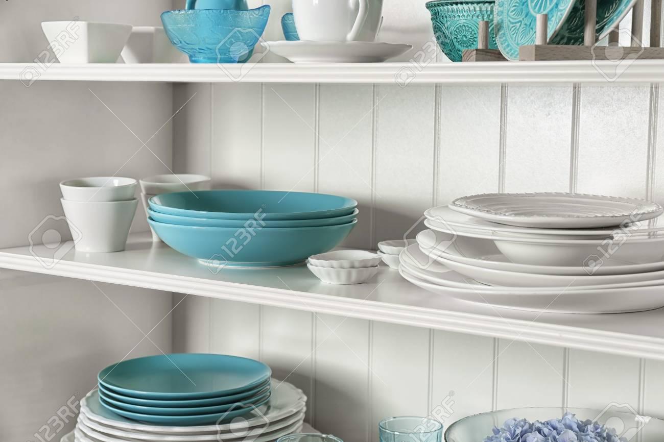 White storage stand with dishware in kitchen - 112362154