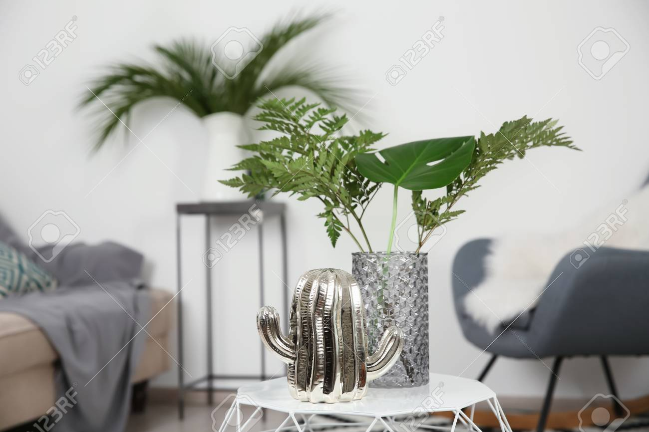 Tropical Leaves In Glass Vase On Table Indoors Stock Photo Picture And Royalty Free Image Image 111239310 Are you searching for tropical leaves png images or vector? 123rf com