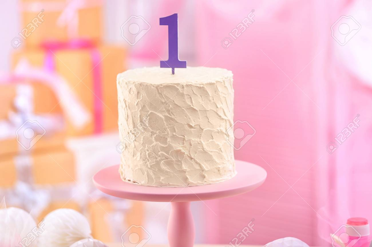 Delicious Vanilla Cake On Stand Indoors First Birthday Celebration