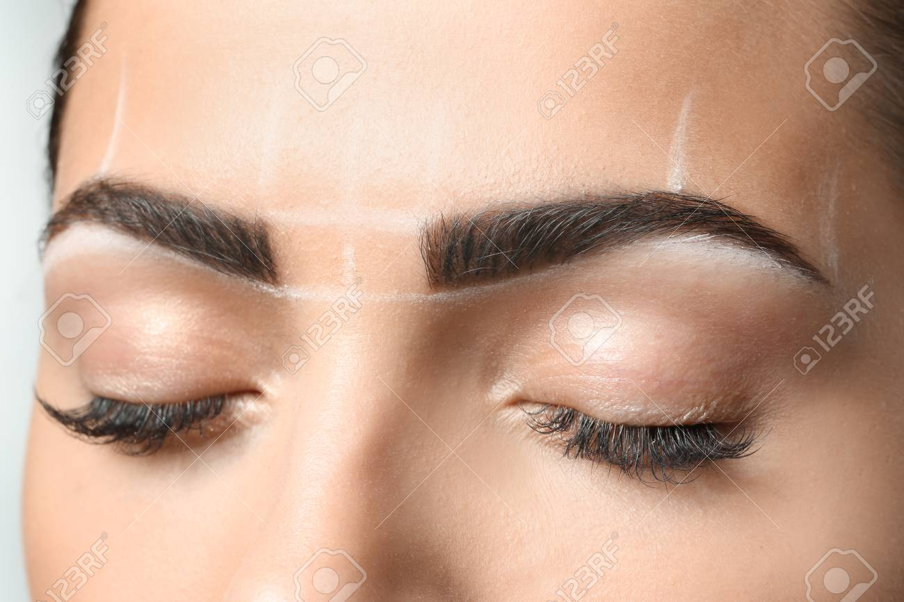 Young Woman Before Procedure Of Eyebrows Permanent Makeup Closeup
