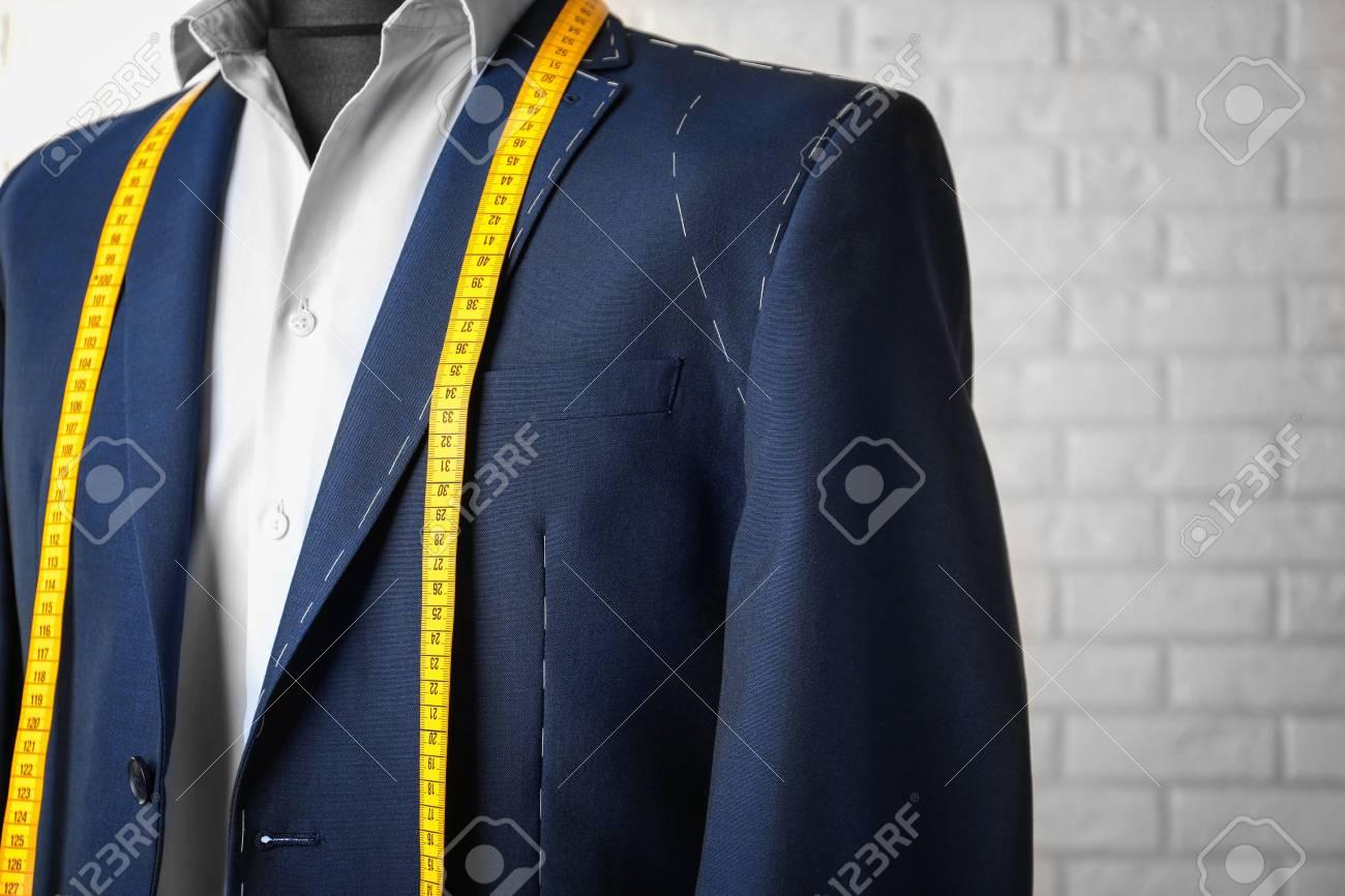 Semi-ready suit on mannequin indoors, closeup - 112520587