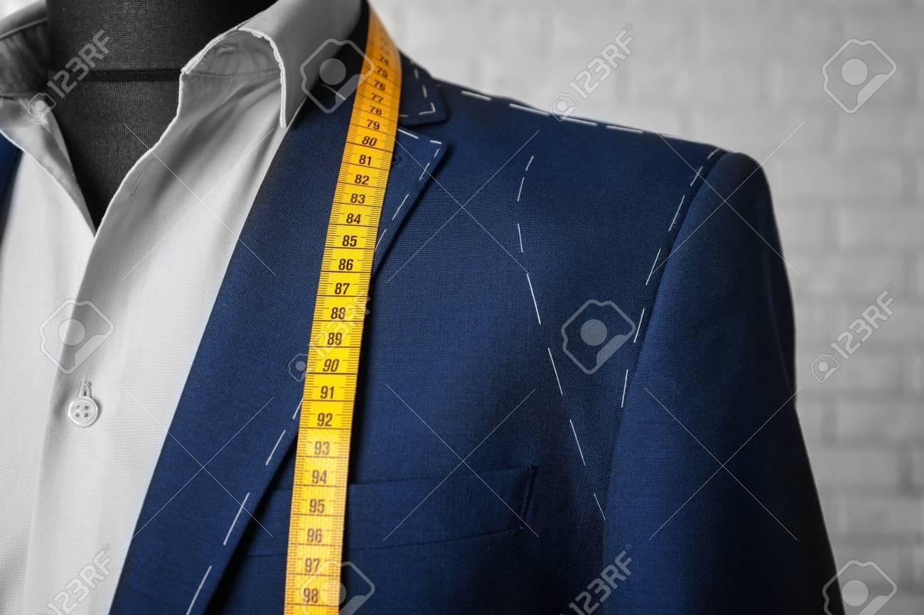 Semi-ready suit on mannequin indoors, closeup - 112520639