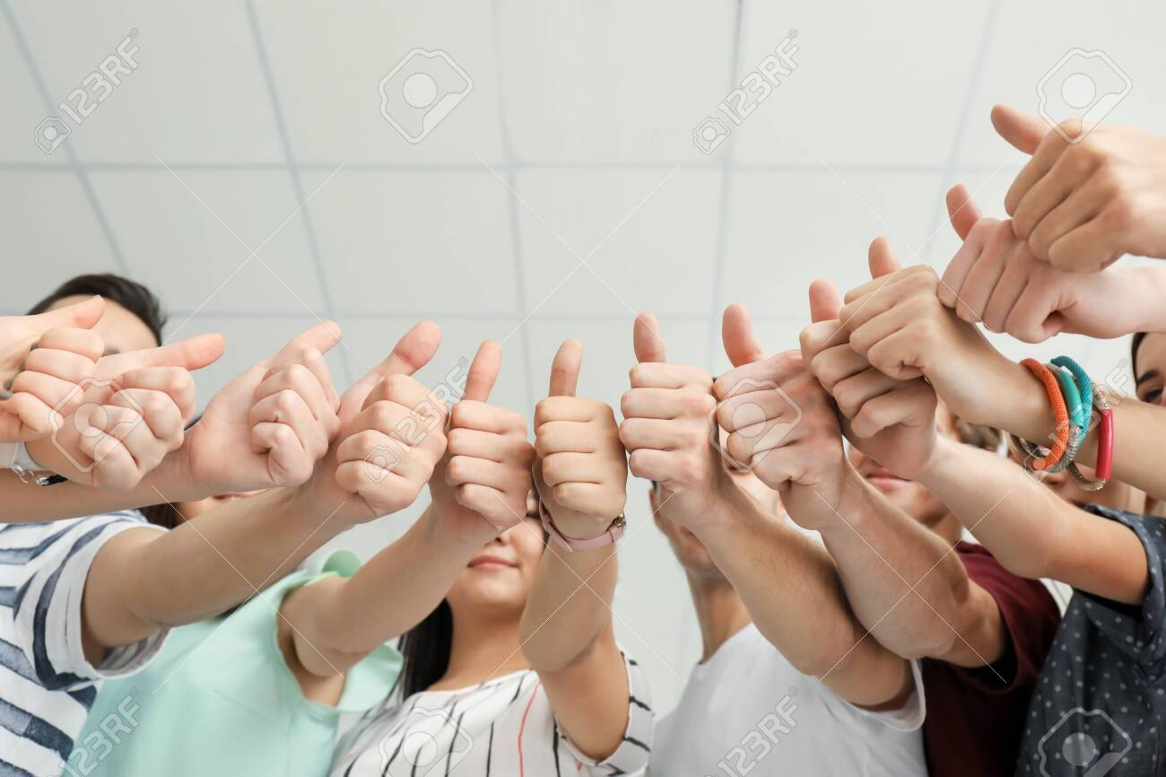 Many People Showing Thumbs Up Together As Symbol Of Unity Stock Photo Picture And Royalty Free Image Image 115199031