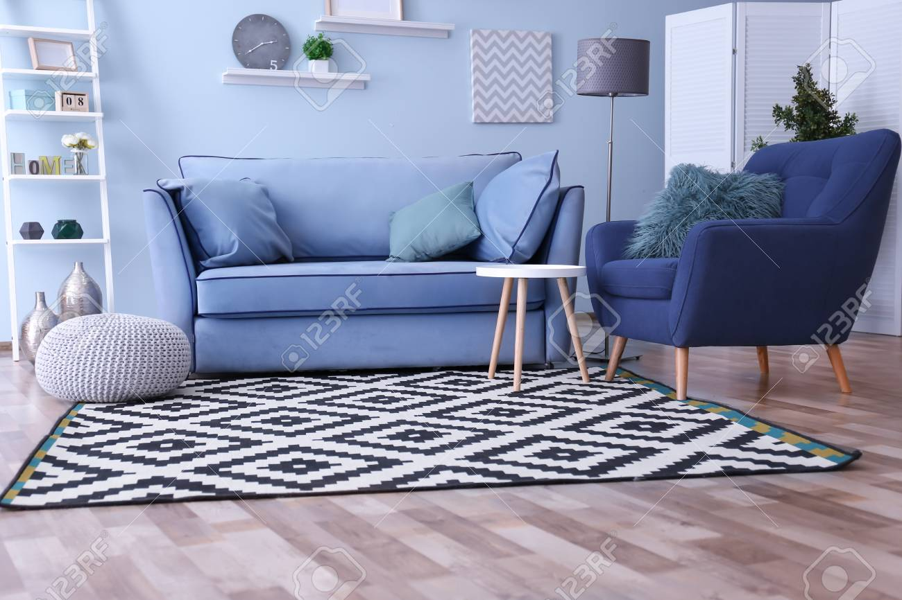 Interior of living room with comfortable armchair and sofa stock photo 112589812