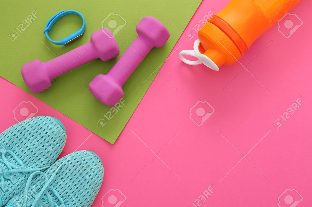 Gym Stuff And Blank Space For Exercise Plan On Color Background ...