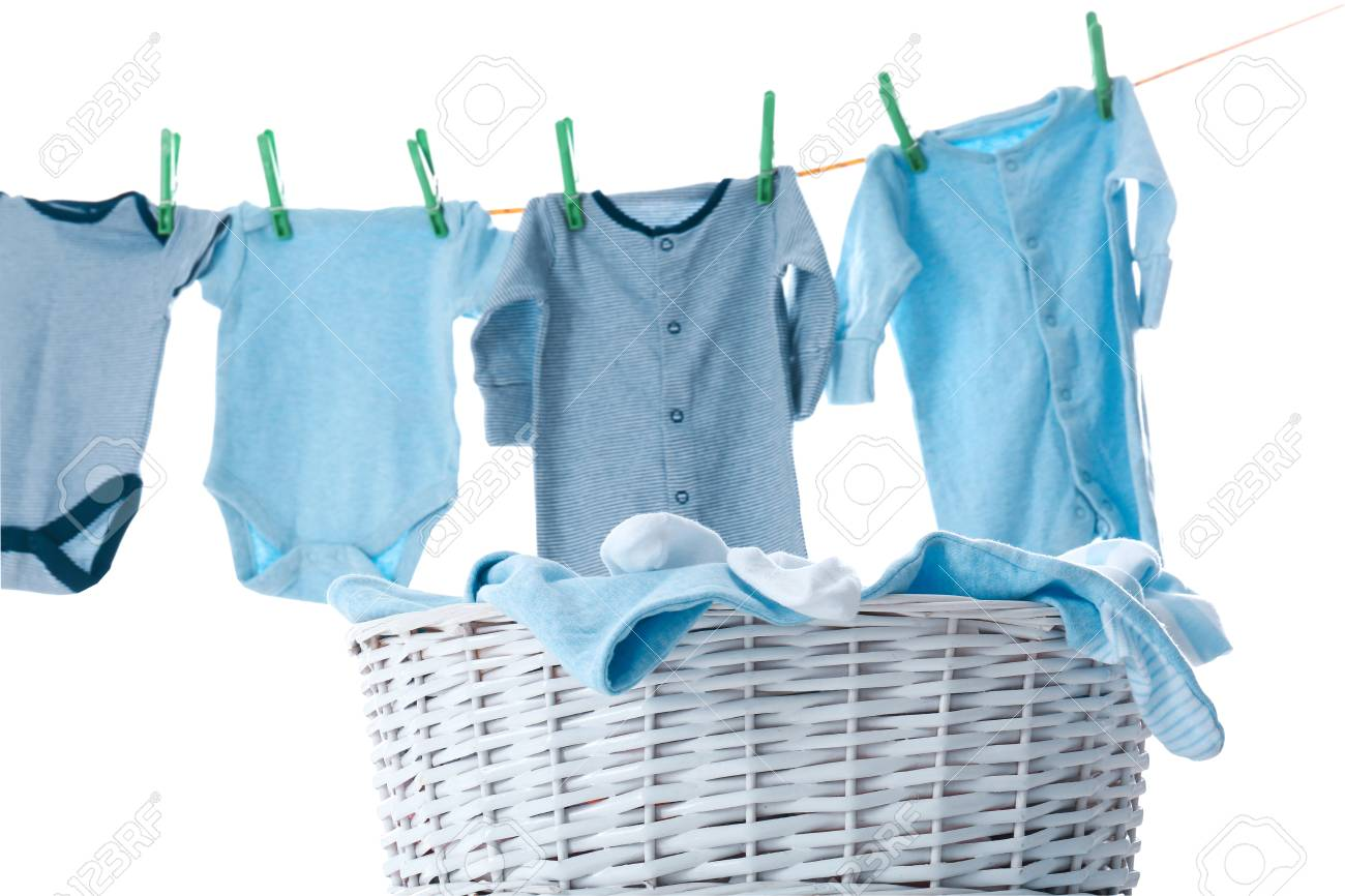 Children's clothes on washing line and laundry basket against white background - 112896364