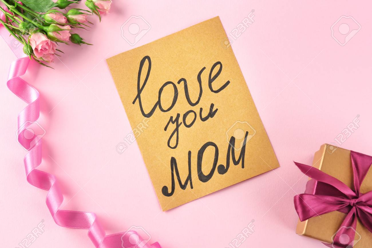 Card With Text Love You Mom Flowers And Gift Box On Color