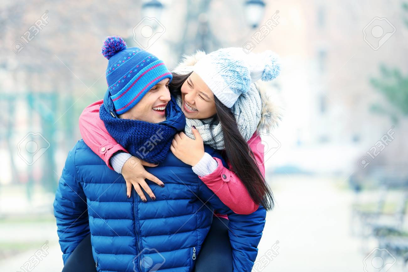 9090ad6b2a5 Happy couple in winter outfit outdoors Stock Photo - 112778214