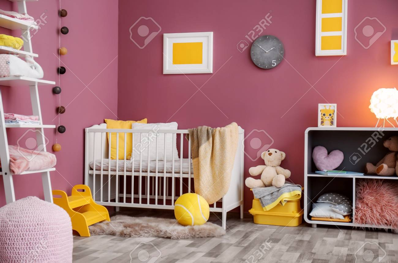 Interior Of Beautiful Modern Childrens Room With Crib Stock Photo