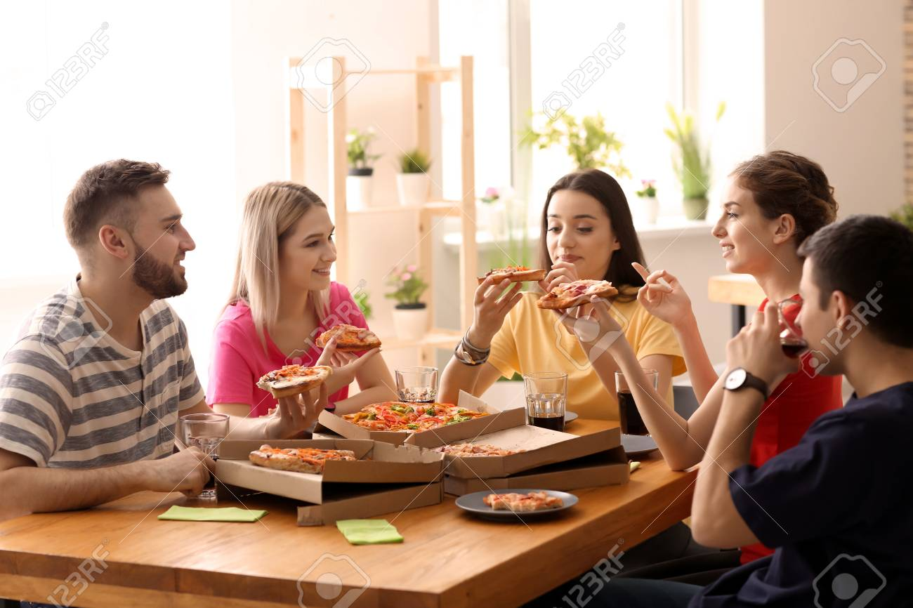 Enjoyable Young People Eating Pizza At Table Indoors Download Free Architecture Designs Embacsunscenecom