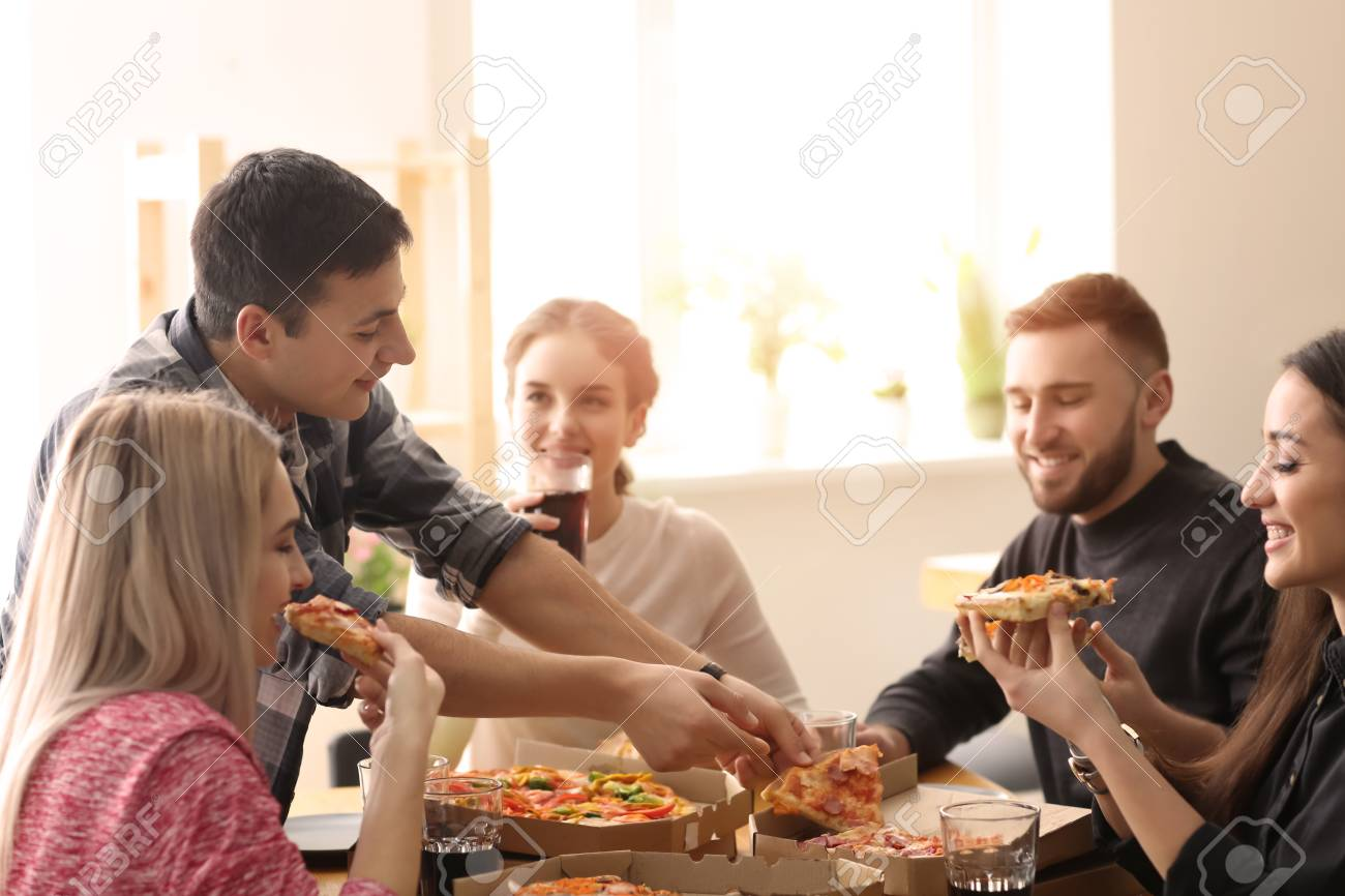 Prime Young People Eating Pizza At Table Indoors Download Free Architecture Designs Embacsunscenecom