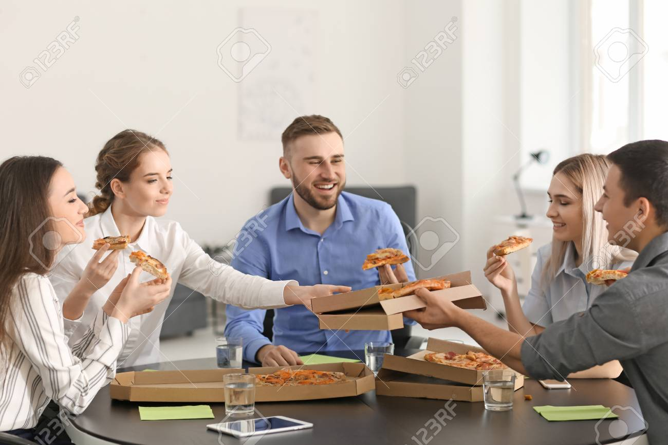 Awe Inspiring Young People Eating Pizza At Table In Office Download Free Architecture Designs Embacsunscenecom