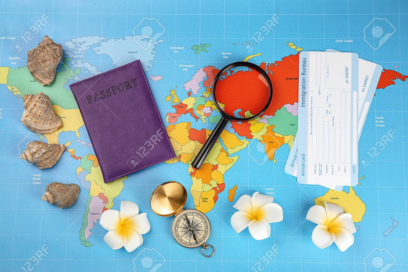 Composition with passport immigration bureau cards and compass on