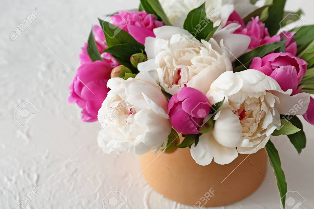 Box With Beautiful Peony Flowers On White Table Stock Photo Picture And Royalty Free Image Image 114688799