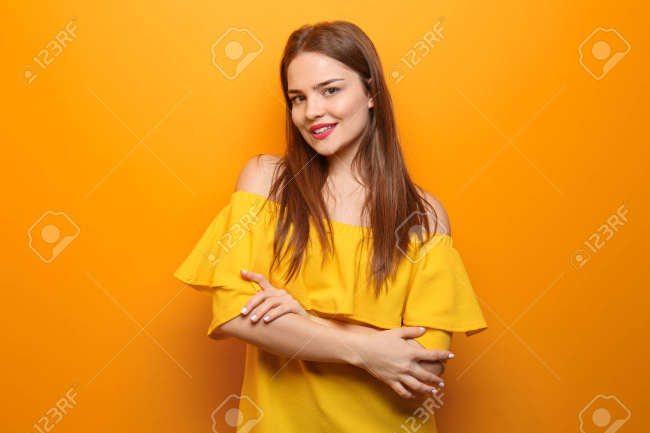 Beautiful young woman on color background - 113536670
