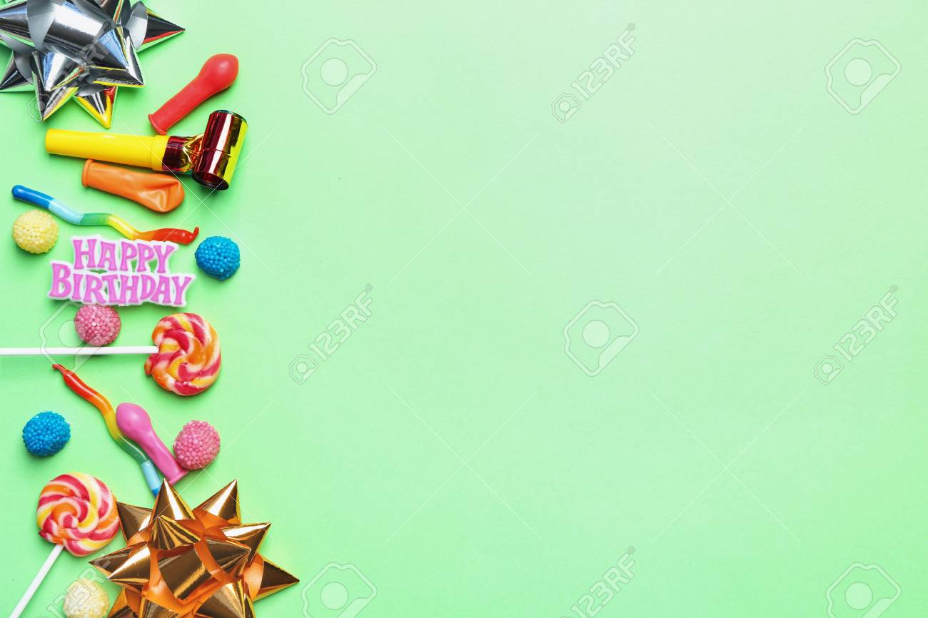 Flat Lay Composition With Birthday Party Items And Candies On