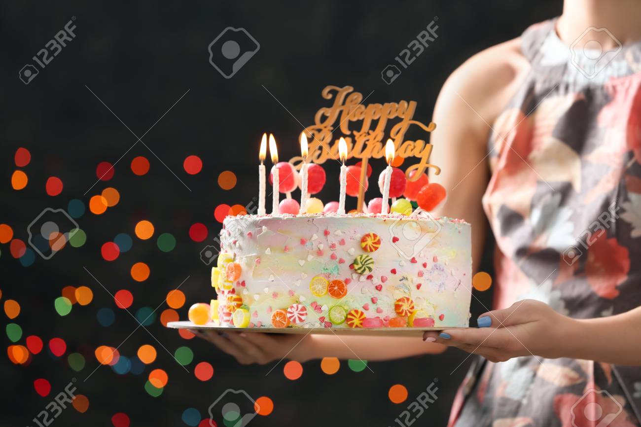 Woman Holding Beautiful Birthday Cake On Dark Background With