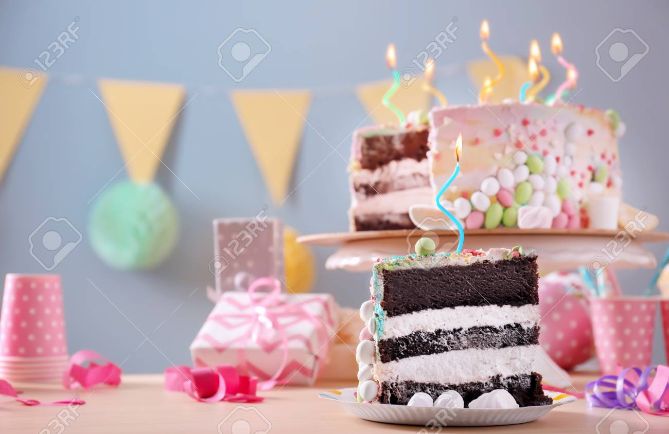 Plate With Piece Of Tasty Birthday Cake On Table Standard Bild
