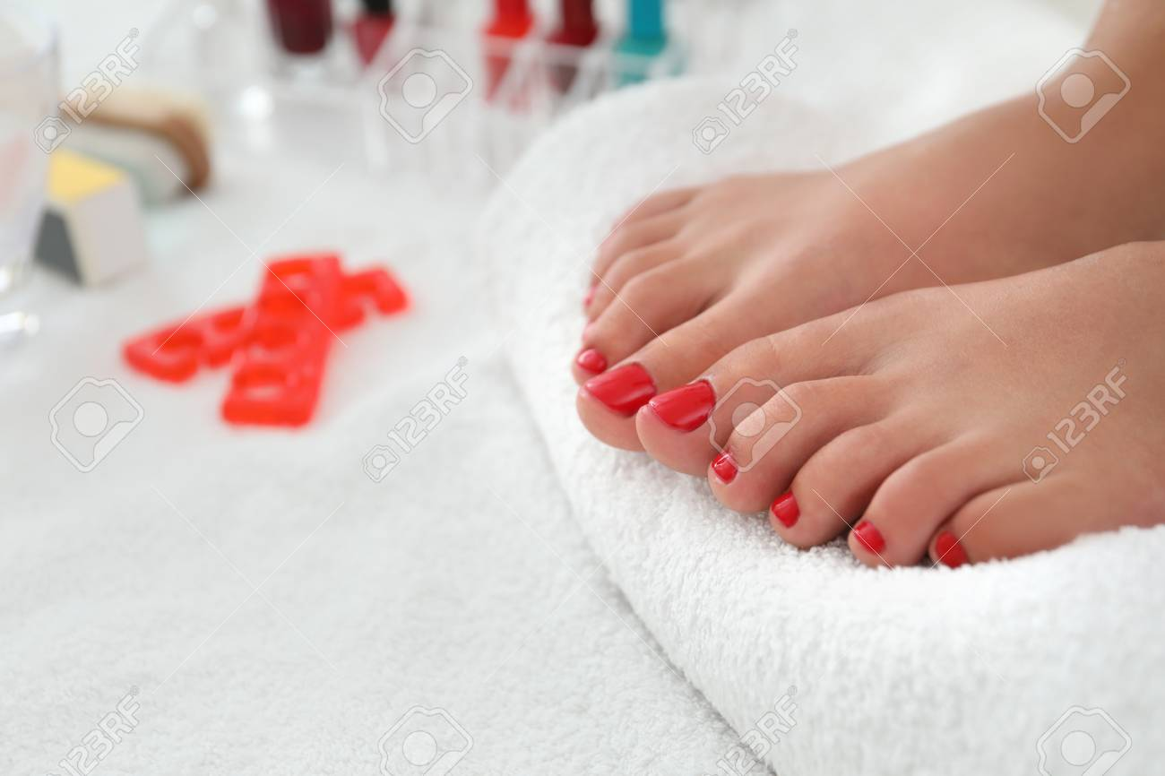 Young woman with stylish pedicure in beauty salon, closeup - 114751133