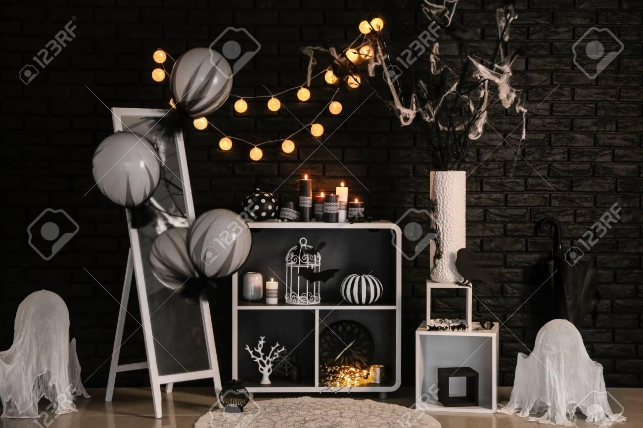 Creative Decorations For Halloween Party Near Dark Brick Wall