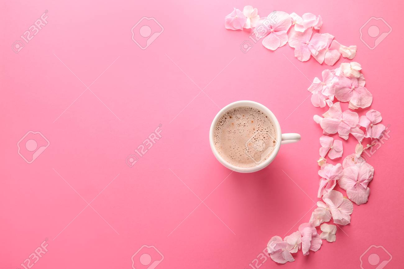 Beautiful flowers and cup of coffee on pink background - 115231544