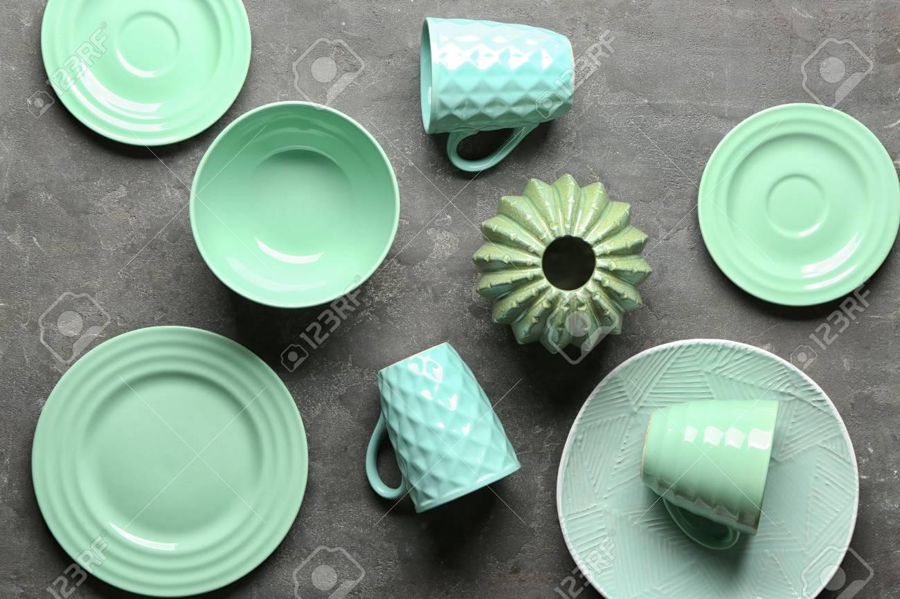 Tableware and decorative vase on grey background - 115550314
