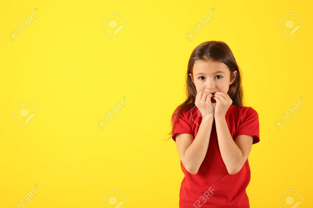Emotional girl after making mistake on color background - 115688122