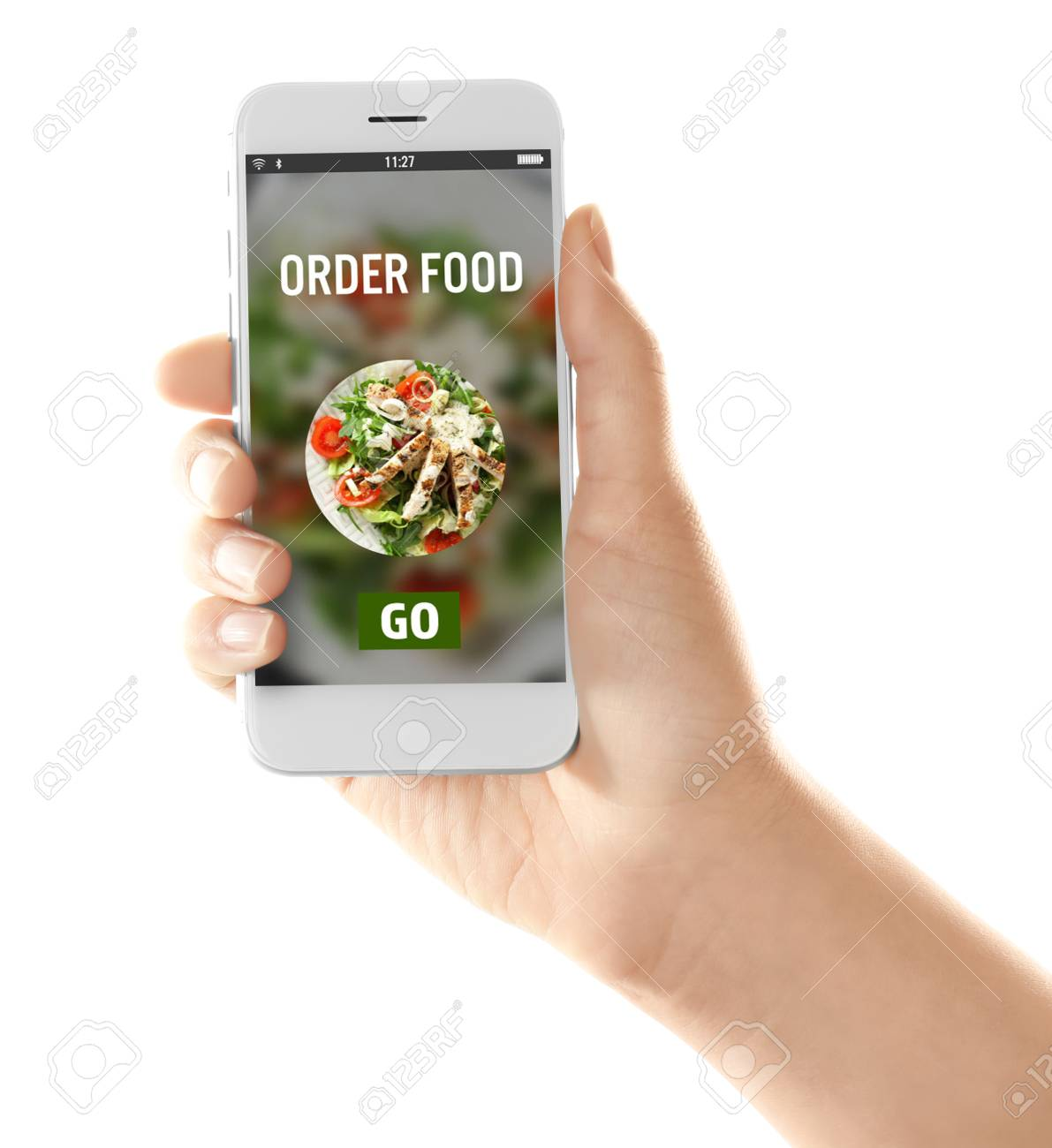 Woman holding mobile phone with open page of food delivery service on white background - 115863798