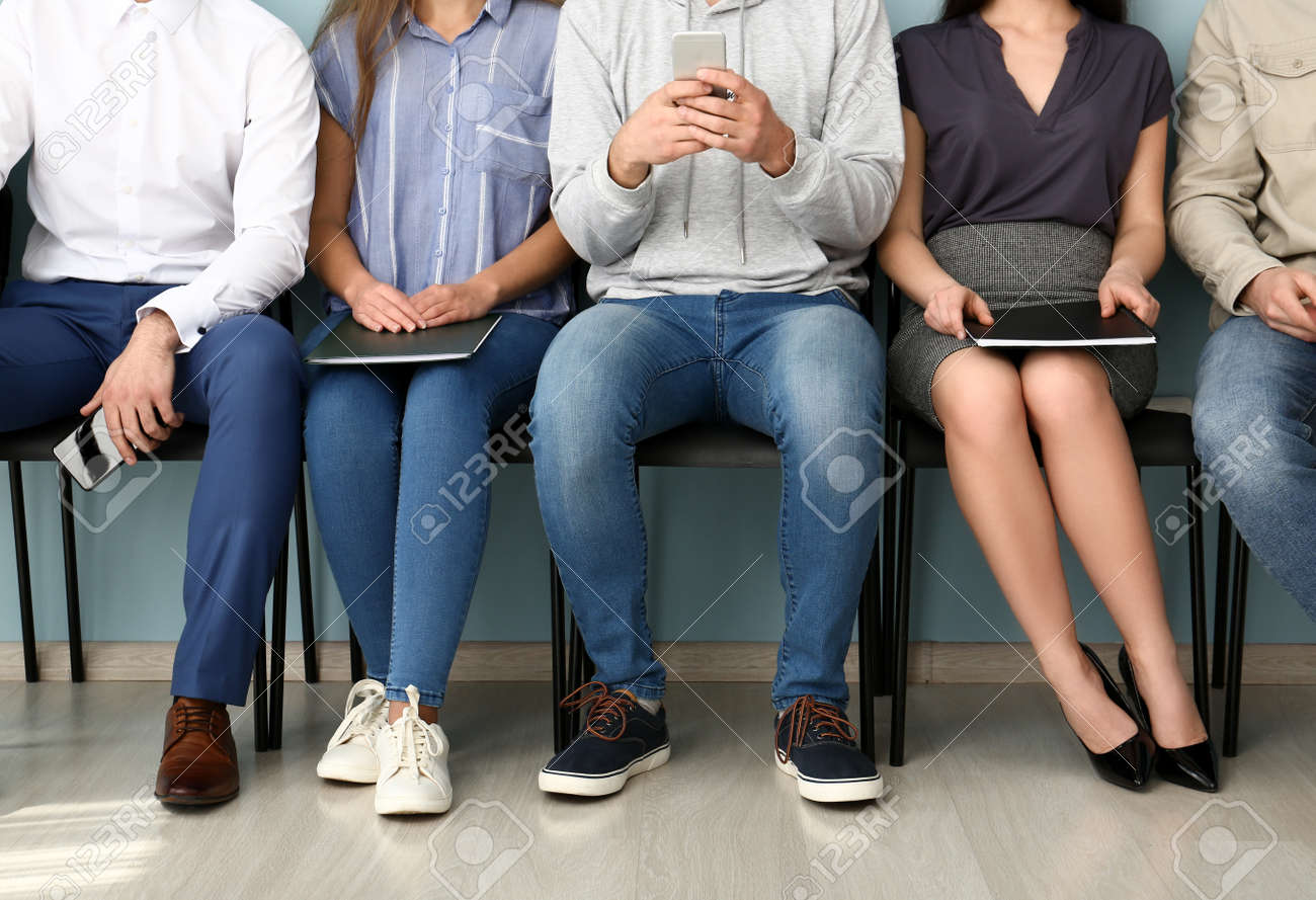 Young people waiting for job interview indoors - 165152212