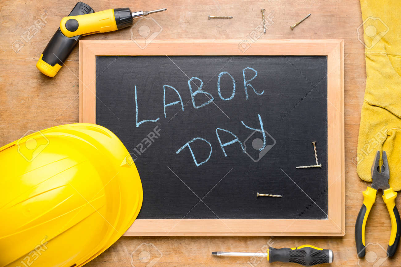 Set of tools and chalkboard with text LABOR DAY on wooden background - 165343376