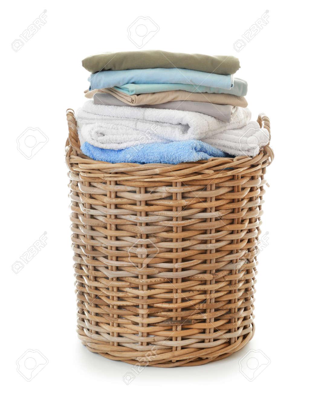 Basket with laundry on white background - 165345046