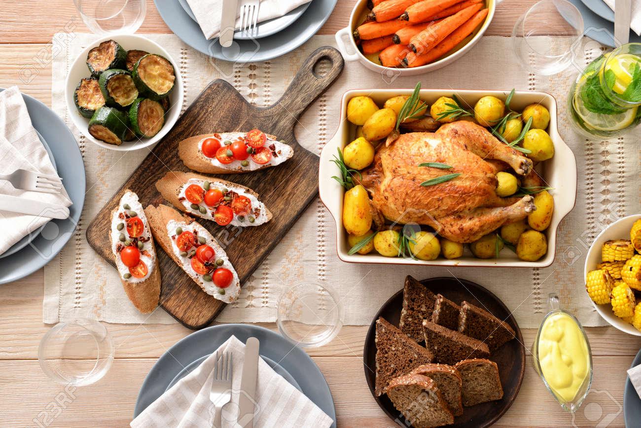 Table set for big family dinner - 165526823